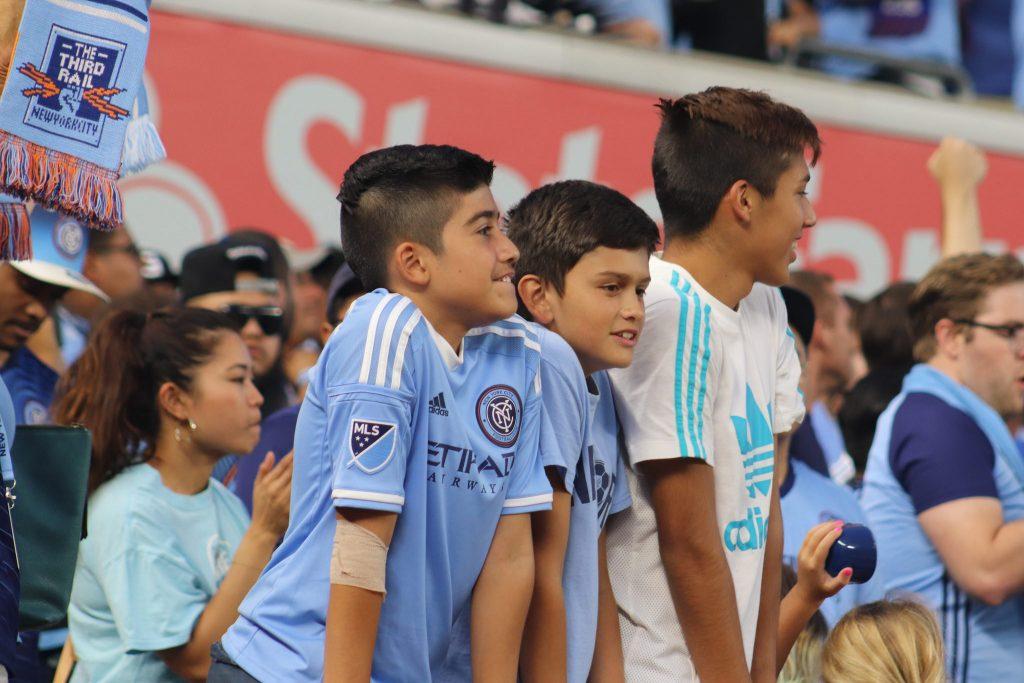 Kids watching soccer by Jen Gallardo